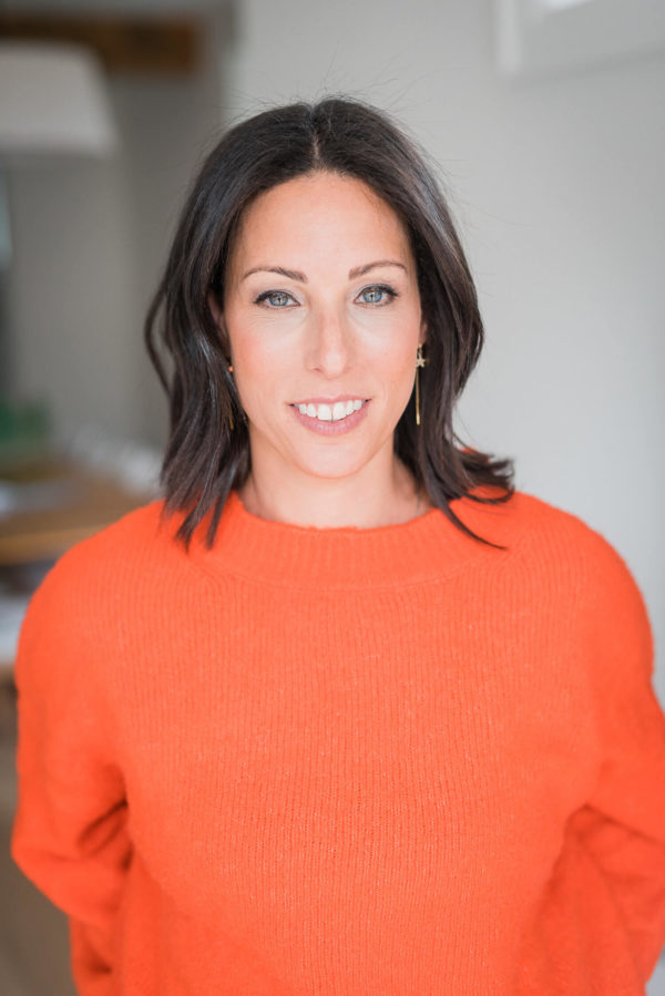 Dr. Jodi Larry ND | Toronto Naturopathic Doctor serving Toronto - Dr. Jodi Larry wearing a orange sweater